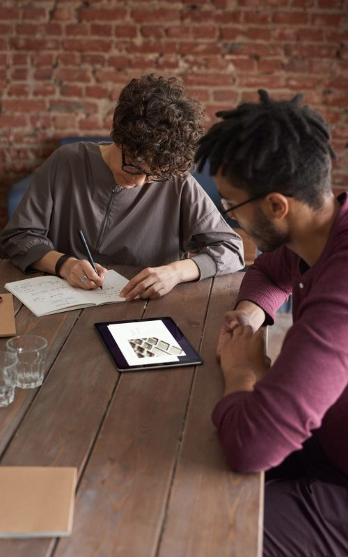 man-wearing-purple-long-sleeved-shirt-looking-at-the-ipad-3184326.jpg
